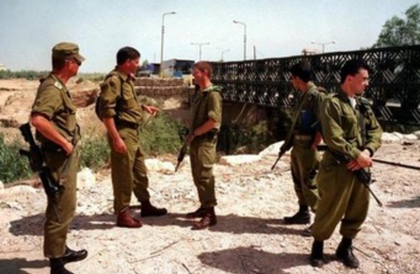 IDF soldiers at the Allenby Bridge crossing near the border with Jordan. (photo credit: REUTERS)