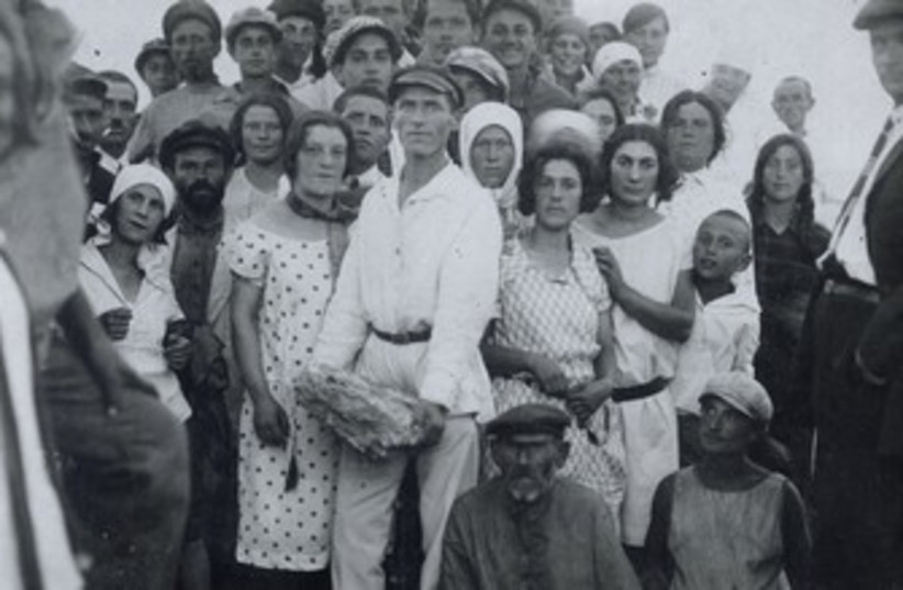 Jewish farmers from a Crimean collective celebrate the cornerstone laying for a new school in 1927  (photo credit: AMERICAN JEWISH JOINT DISTRIBUTION COMMITTEE ARCHIVES/ JTA)