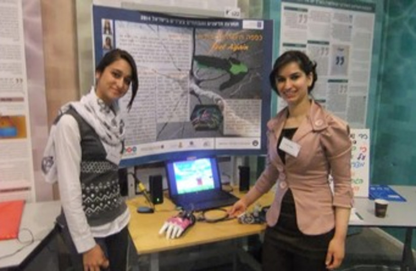 Two girls from Baka el-Garbia present their research (photo credit: JUDY SIEGEL-ITZKOVICH)