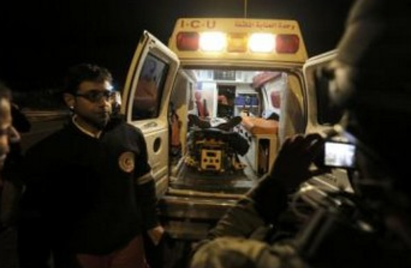 Ambulance in West Bank after Palestinian killed (photo credit: REUTERS)
