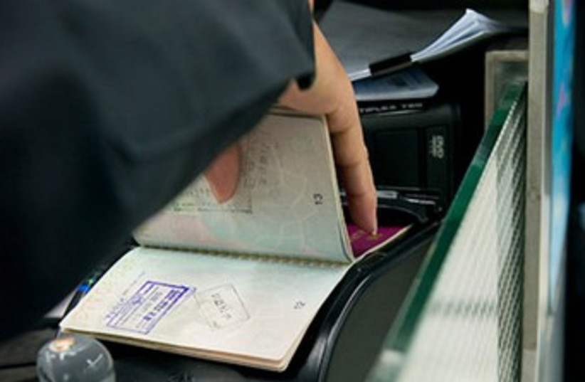 Passport check (photo credit: INTERPOL WEBSITE)