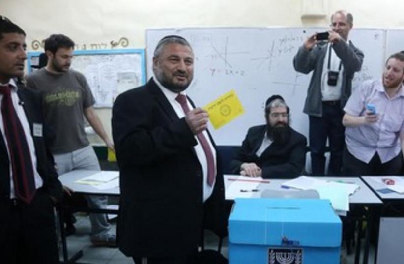 Abutbul votes in Beit Shemesh election (photo credit: MARC ISRAEL SELLEM/THE JERUSALEM POST)