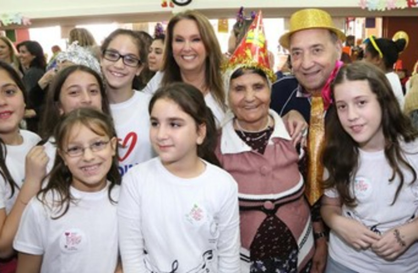 Shari Arison, initiator of Good Deeds Day at a Purim party for the elderly organized by school children. (photo credit: SIVAN FARAG)