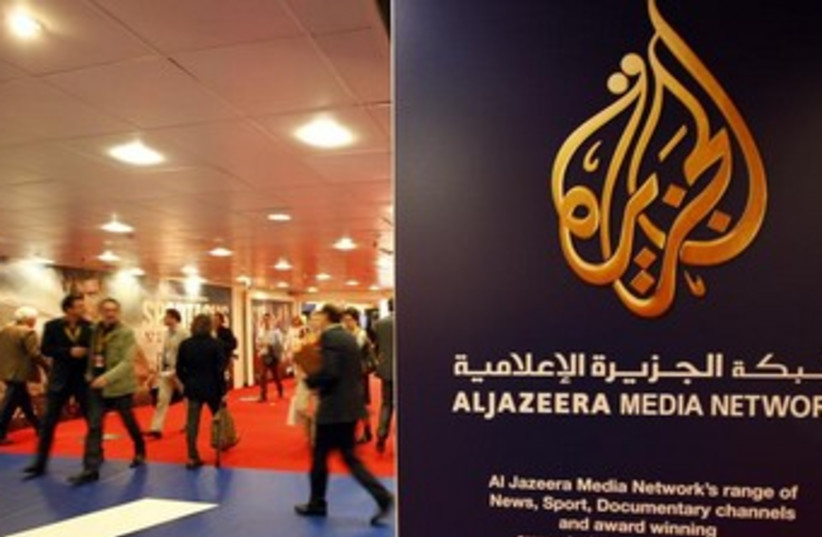 A sign with the logo of Al Jazeera Media Network (photo credit: REUTERS)