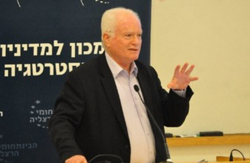 Amos Gilad speaking at conference (photo credit: KOBI ZOLTAK)