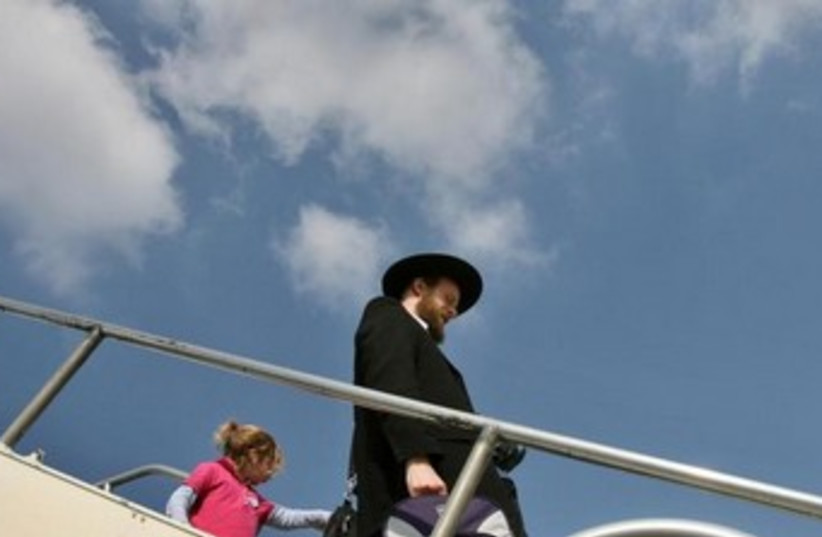 Haredi leaves plane [illustrative] (photo credit: REUTERS)