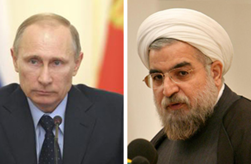 Putin and Rouhani at Bushehr (photo credit: REUTERS)