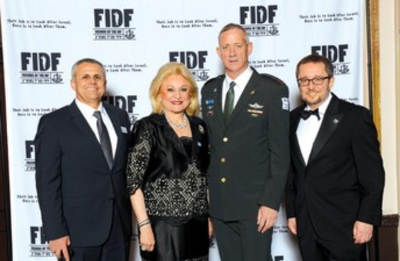 FIDF head Maj.-Gen. (res.) Jerry Gershon, National Chairwoman Nily Falic, IDF Chief of Staff Lt.-Gen. Benny Gantz and FIDF chairman emeritus Arthur Stark. (photo credit: SHAHAR AZRAN)