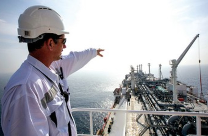 An officer stands on the tanker 'Excellence' anchored in the Mediterranean, which carries liquefied natural gas.  (photo credit: REUTERS)
