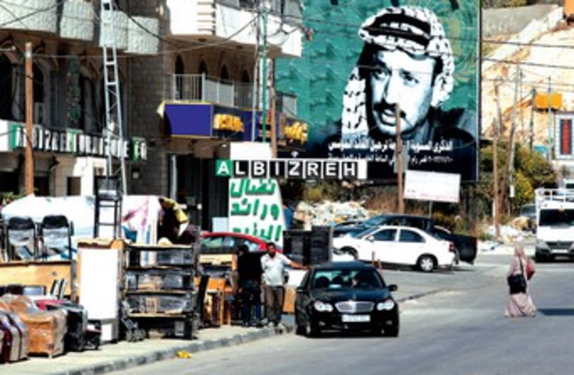 A poster of late Palestinian leader Yasser Arafat near the entrance to Ramallah. (photo credit: REUTERS)
