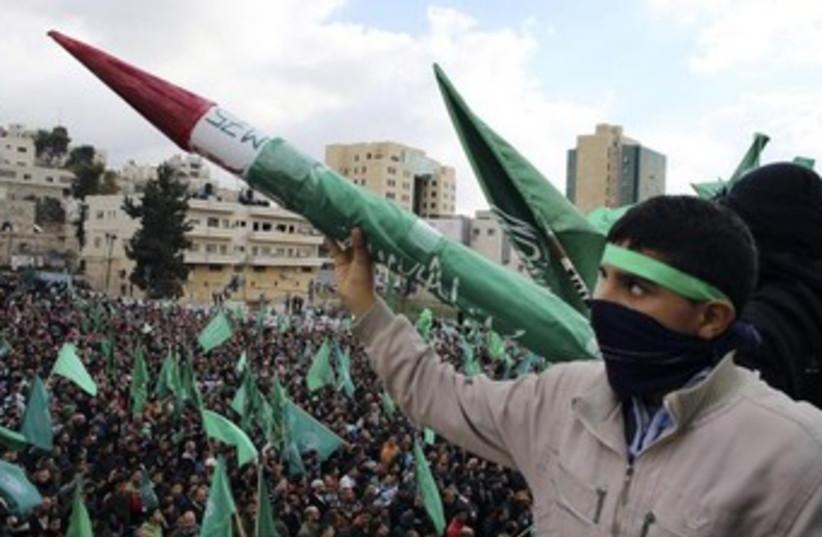 Palestinian youth hold Hamas-made rocket [File] (photo credit: REUTERS)