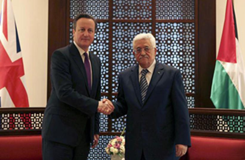 Palestinian President Mahmoud Abbas with British PM David Cameron (photo credit: REUTERS)
