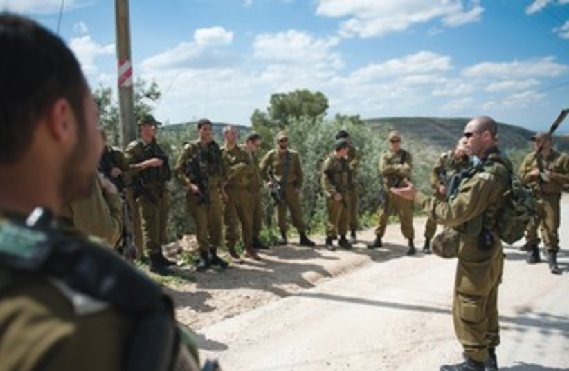 COMMANDER OF the 7th Brigade's 77th Armored Battalion Lt.-Col. Yair Or addresses his officers near the West Bank village of Idna. (photo credit: COURTESY IDF SPOKESMAN'S OFFICE)