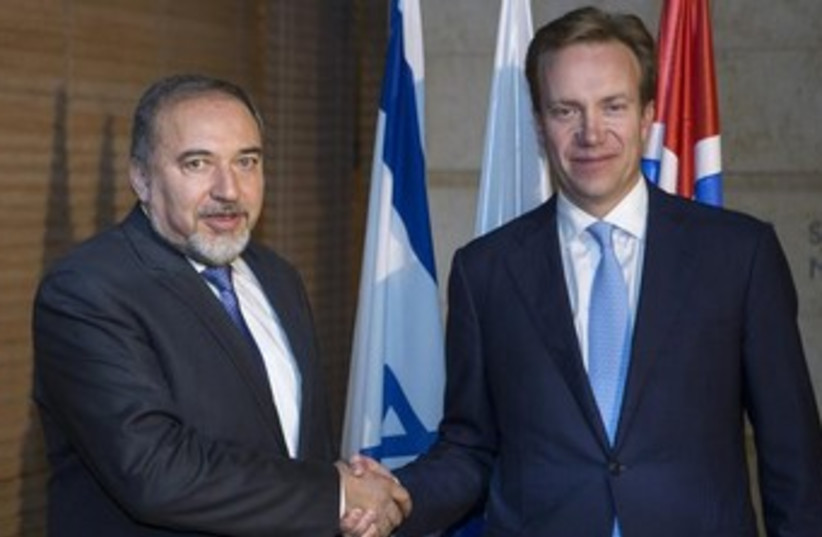 Foreign Minister Avigdor Liberman (L) greets Norway's foreign minister, Borge Brende, in November. (photo credit: REUTERS)