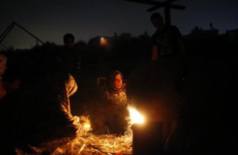 Palestinians in Gaza brave a power outage this past November. (photo credit: REUTERS)