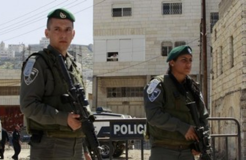 Border Police officers stand guard in Hebron. (photo credit: REUTERS)