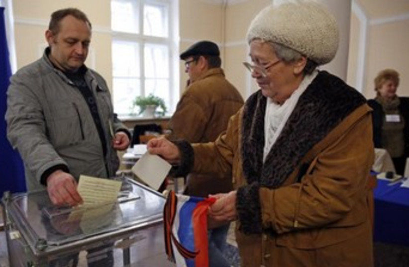 Voters inreferendum on the status of Ukraine's Crimea (photo credit: REUTERS)