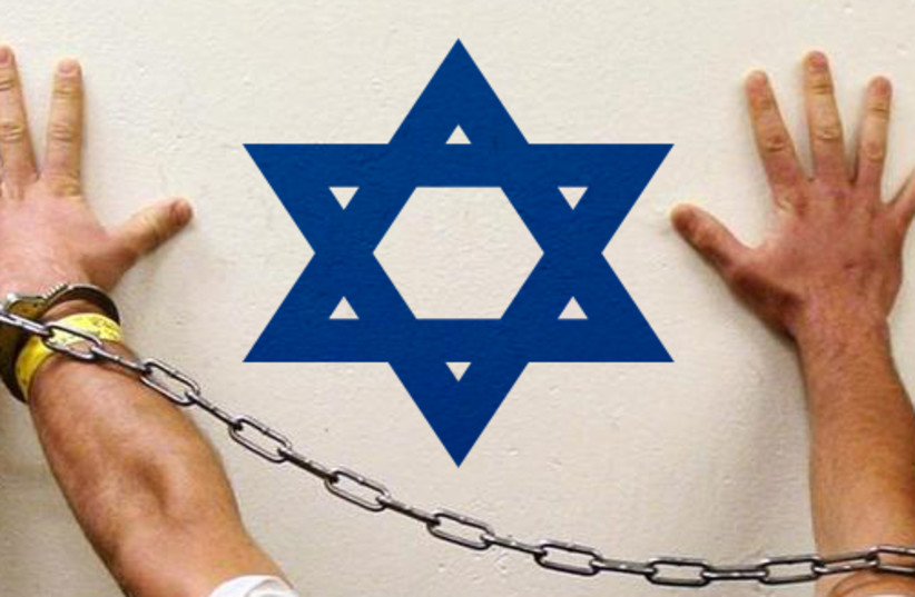 Man arrested for Israel ties [illustrative] (photo credit: REUTERS)