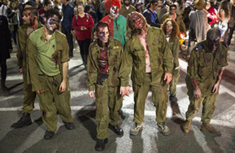 """Zombie Walk"" for the Jewish holiday of Purim in Tel Aviv, March 16, 2014 (photo credit: REUTERS)"
