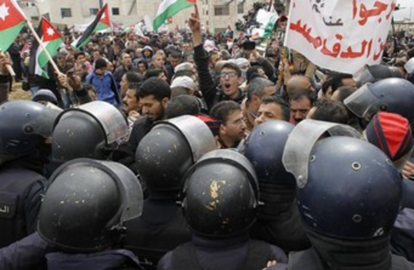 Jordanians protest outside the Israeli embassy in the capital of Amman. (photo credit: REUTERS)