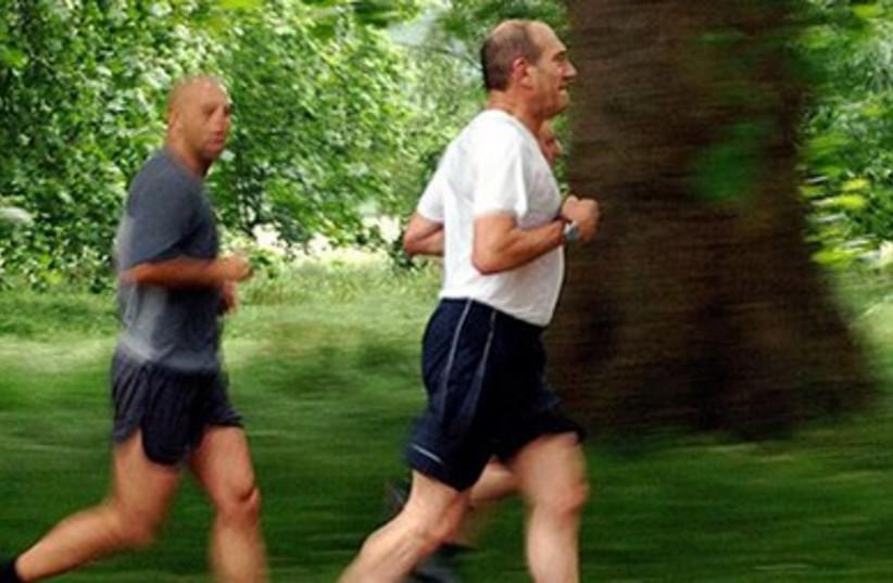 Knesset exhibit: Ehud Olmert running, 2006 (photo credit: KNESSET)