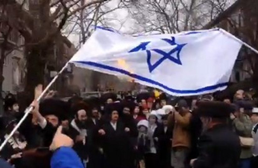 Satmar Hasidim in New York torch Israeli flag during Purim. (photo credit: screenshot)
