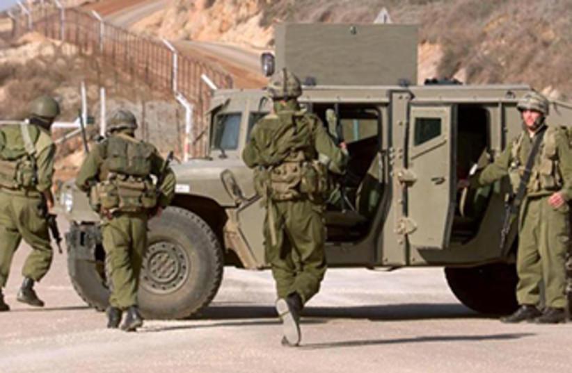 IDF jeep on northern border (photo credit: REUTERS)
