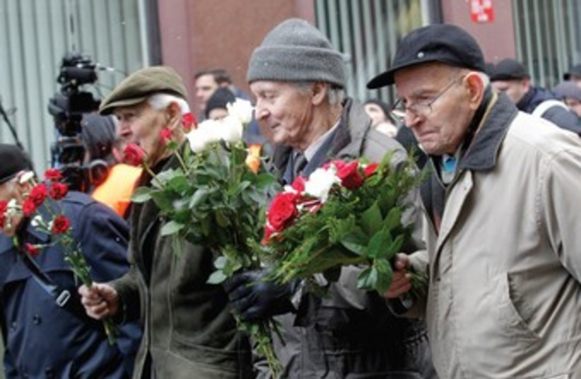 PEOPLE TAKE part in the annual procession commemorating the Latvian Waffen-SS (Schutzstaffel) unit, also known as the Legionnaires, in Riga on March 16. (photo credit: REUTERS)