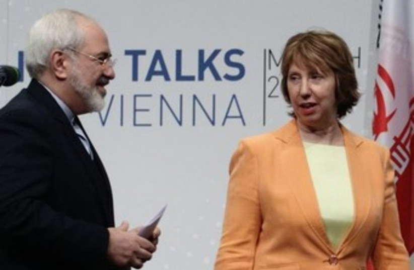 Iranian FM Mohammad Javad Zarif (L) and EE foreign policy chief Catherine Ashton at nuclear talks in Vienna March 19, 2014.  (photo credit: REUTERS)