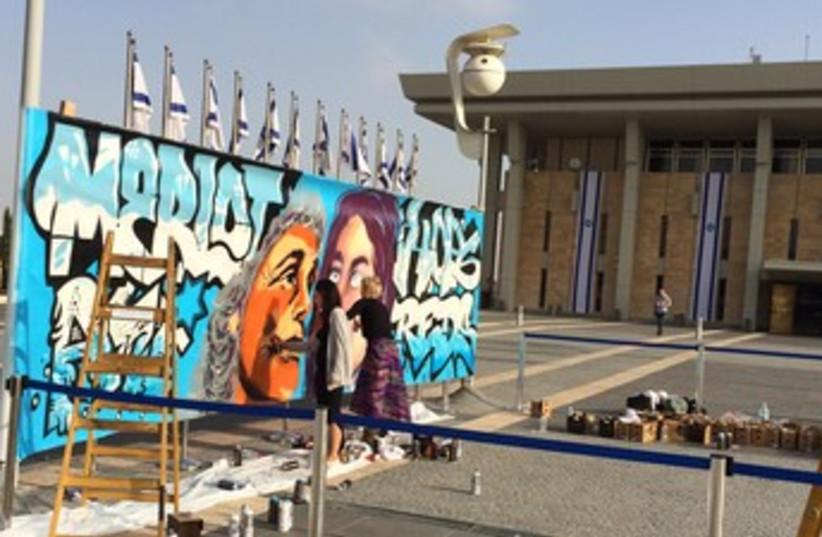 Artists painted graffiti outside the Knesset. (photo credit: Lahav Harkov)