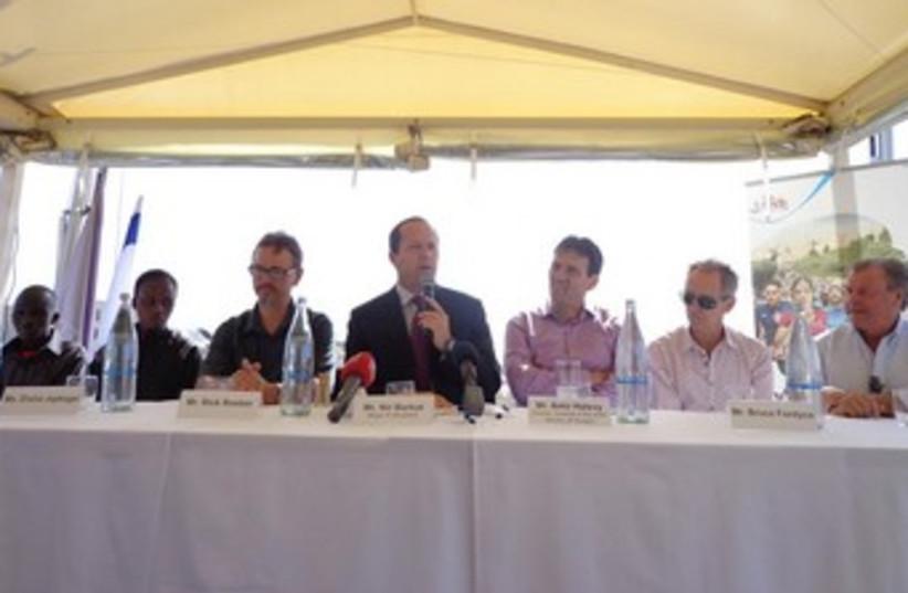Jerusalem Mayor Nir Barkat (center) at press conferenc on the Mamilla Hotel rooftop, March 20, 2013. (photo credit: STEVE LINDE)