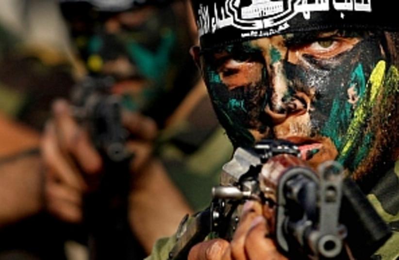 al aksa points gun 298 (photo credit: AP [file])