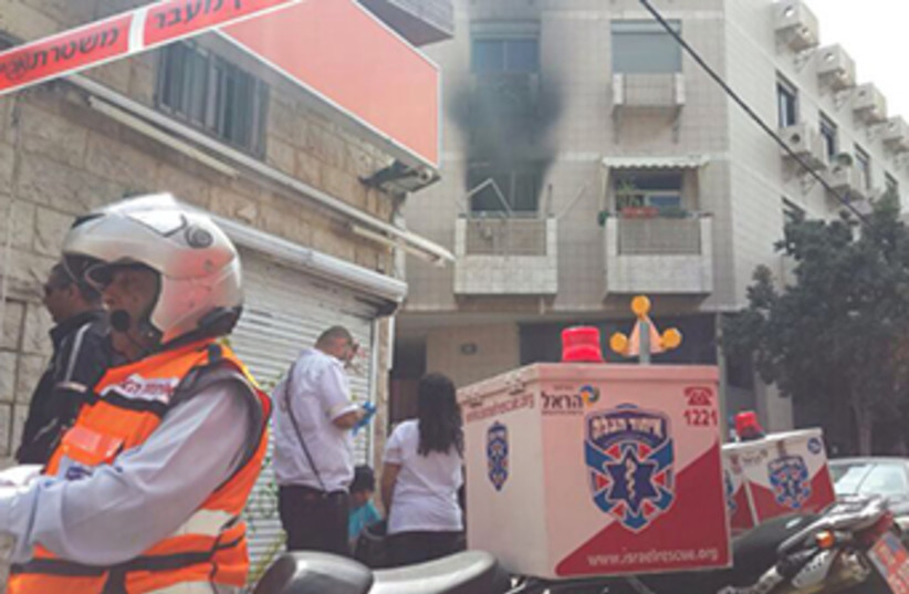 The scene outside a south Tel Aviv apartment hit by a suspected gas cannister explosion (photo credit: UNITED HATZALAH)