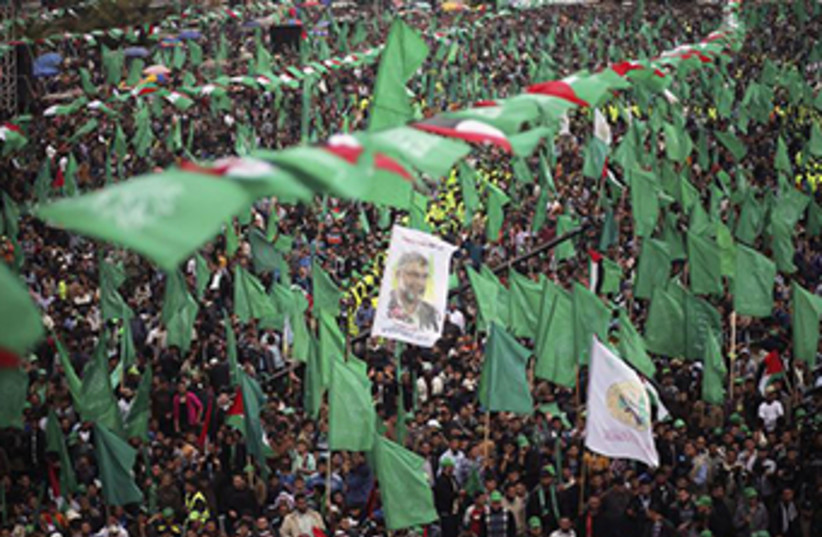 Hamas supporters attend a massive rally in Gaza‏ (photo credit: REUTERS)