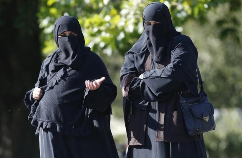 Women in full face veils walk in London's Regents Park (photo credit: REUTERS)