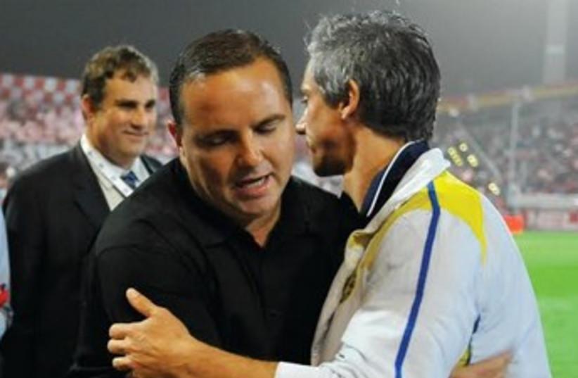 Maccabi Tel Aviv coach Paulo Sousa (right) and Hapoel Tel Aviv coach Ran Ben-Shimon (left). (photo credit: ASAF KLIGER)