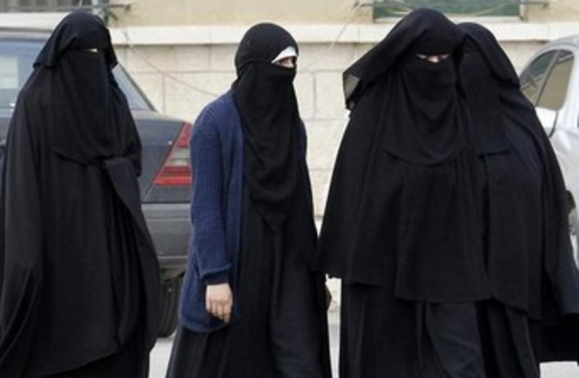 Jordanian women are seen with religious head-covering. (photo credit: REUTERS)