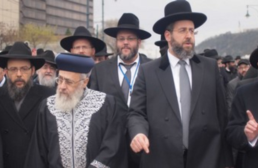Israel's chief rabbis, Yitzhak Yosef (R) and David Lau, in Hungary to comemorate the 70th anniversary of the Holocaust. (photo credit: SAM SOKOL)