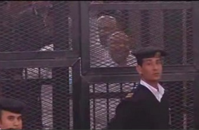 Muslim Brotherhood in court cages (photo credit: REUTERS)