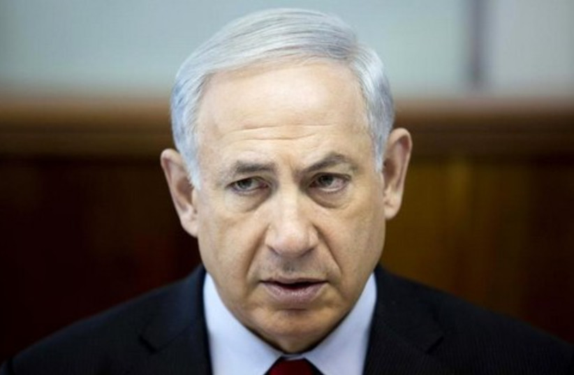 Benjamin Netanyahu attends the weekly cabinet meeting at his office in Jerusalem March 23, 2014.  (photo credit: REUTERS)