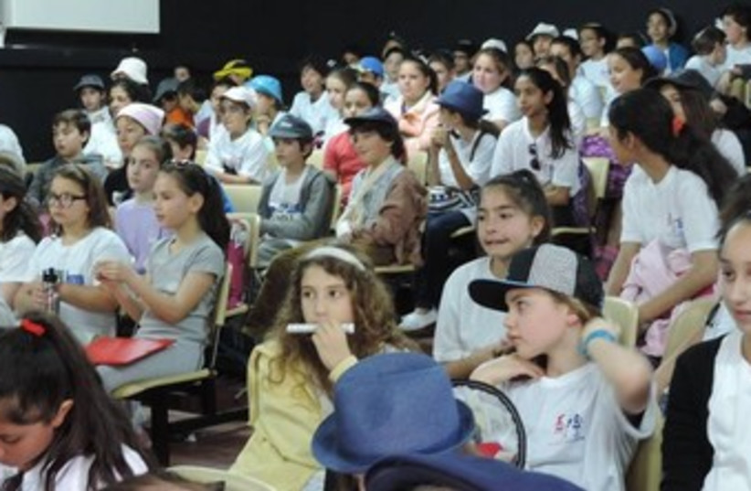 French and Swiss fourth grade students along with their Israeli counterparts at the Mikveh Israel School in Holon (photo credit: COURTESY KOL ISRAEL HAVERIM)