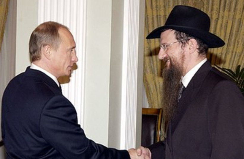 Russian President Vladimir Putin, left, meeting with the Chief Rabbi of Russia Berel Lazar, March 2005 (photo credit: KREMLIN/ JTA)