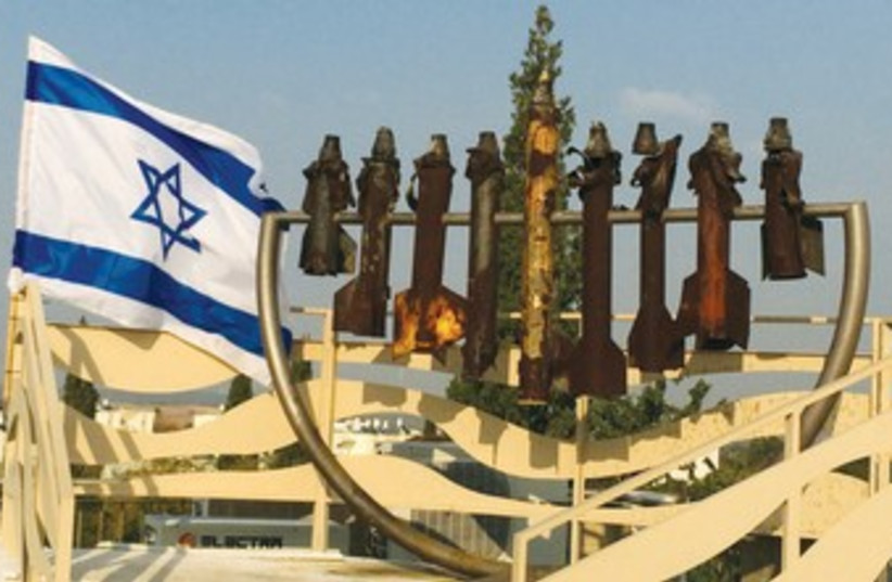 A Hanukkia atop the Sderot Yeshiva is made of rockets that were shot from the Gaza Strip. (photo credit: JORDANA LEBOWITZ)