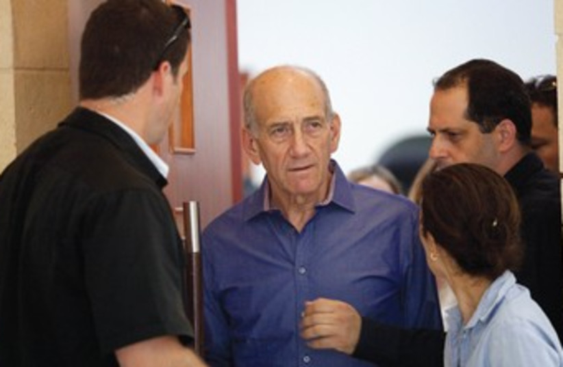 Former prime minister Ehud Olmert leaves the court room after a hearing during a previous corrupution trial. (photo credit: REUTERS)