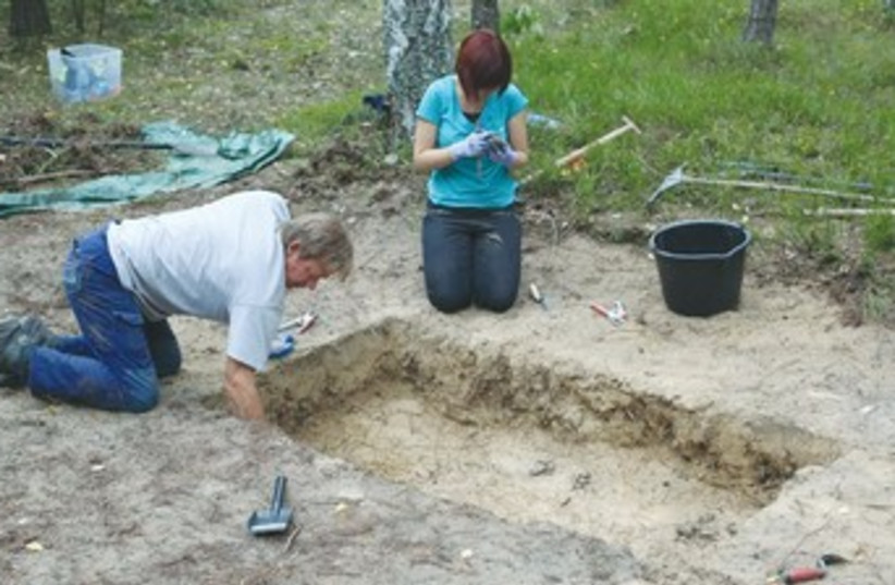 Forensic archeologists excavate the site of the Treblinka death camp in an effort to reconstruct it. (photo credit: REUTERS)