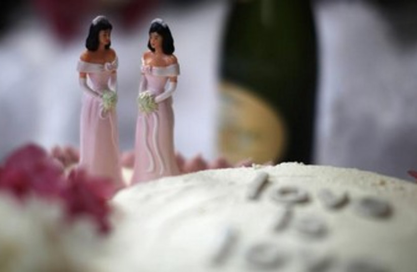 A wedding cake is seen at a reception for same-sex couples. (photo credit: REUTERS)