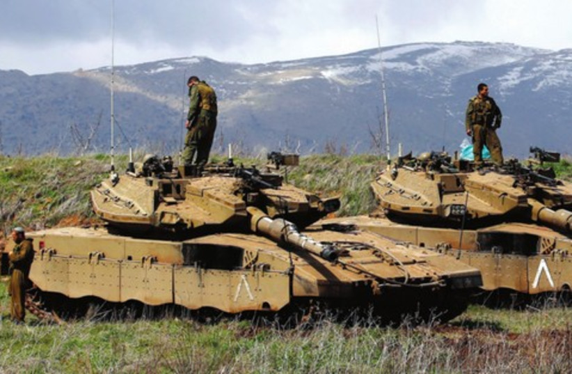 IDF tanks are deployed on Golan, March 19, after IAF hit Syria military sites in response to a roadside bomb (photo credit: REUTERS/Ronen Zvulun)