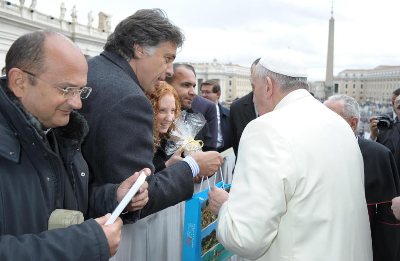 Pope Franciscus receiving gift from delegation from University of Haifa (photo credit: VATICAN PHOTO SERVICE)