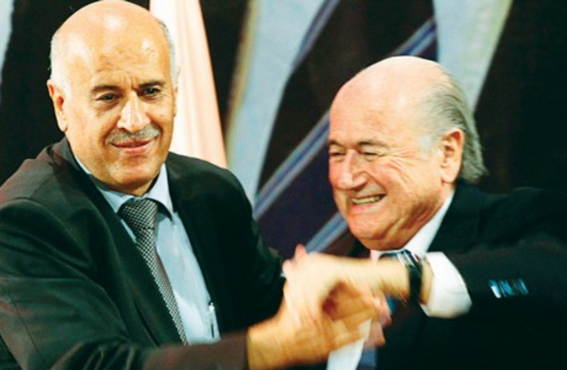 Palestinian FA chairman Jibril Rajoub (L) and FIFA boss Sepp Blatter (photo credit: REUTERS)