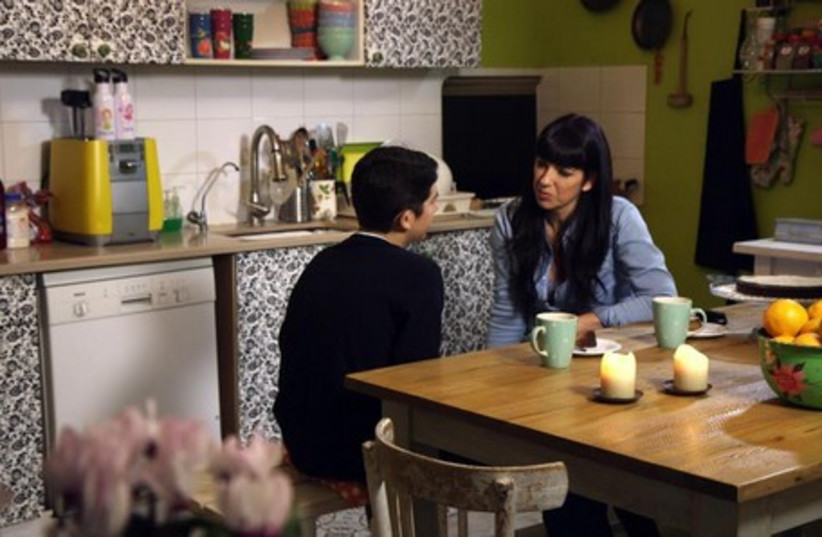 Hagit Ron-Rabinovich and her son Adam in the film 'This is My Brother'. (photo credit: Courtesy)